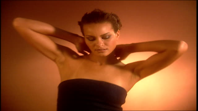 model posing in dark colored camisole and gold pants - camisole stock videos & royalty-free footage