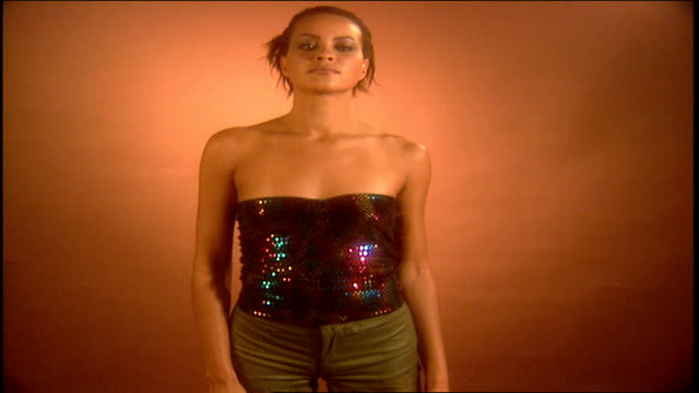 model posing in multi colored sequins camisole and gold pants - camisole stock videos & royalty-free footage