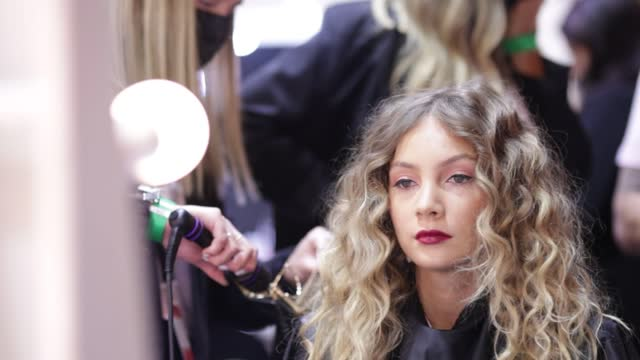 model prepares backstage ahead of the indigenous fashion projects show during afterpay australian fashion week 2021 resort '22 collections at... - carriageworks stock videos & royalty-free footage