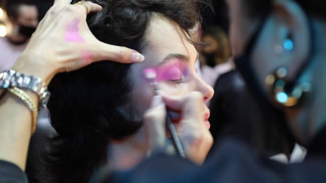 model prepares backstage ahead of the romance was born show during afterpay australian fashion week 2021 resort '22 collections at carriageworks on... - andrew mathers stock videos & royalty-free footage
