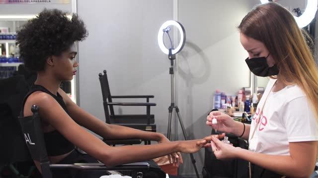 model prepares backstage prior to the catwalk of spanish designer agatha ruiz de la prada show during mercedes benz fashion week madrid september... - human finger stock videos & royalty-free footage