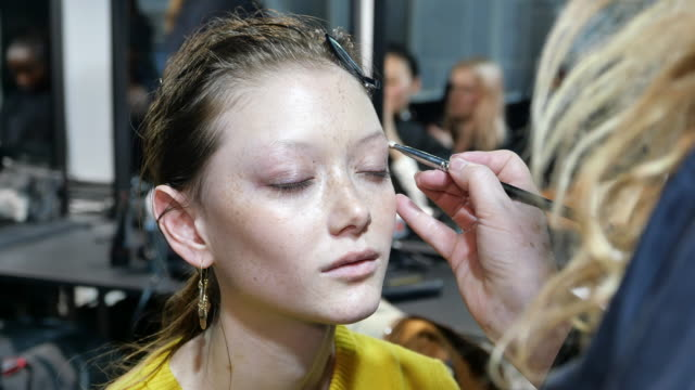 model sara grace is seen having eyebrow definition detail during the make up at alberta ferretti backstage fashion show milan fashion week... - milan fashion week stock videos & royalty-free footage