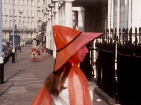 a model shows off a pink transparent coneshaped plastic hat in a london street 1969 - 1960 1969 video stock e b–roll