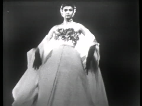 model shows off the latest french designer fashions in evening gowns in 1951 paris. - 1951 stock videos & royalty-free footage