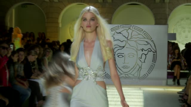 model slips and falls versace: milan fashion week spring/summer 2012 on september 23, 2011 in milan, italy - versace designer label stock videos & royalty-free footage