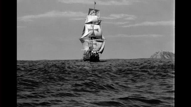 model, spanish galleon at sea with rocky shore in background. model, spanish galleon on january 01, 1940 - spagna video stock e b–roll
