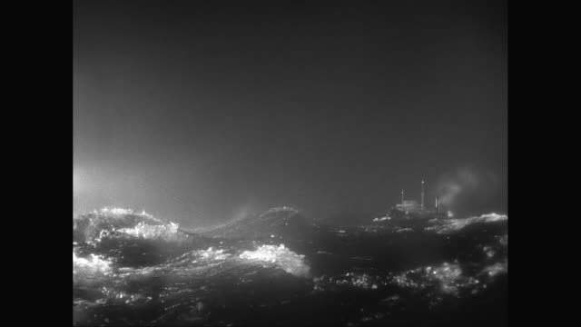 ws model steam ship sailing in rough, stormy sea with high waves at night / united states - militärschiff stock-videos und b-roll-filmmaterial