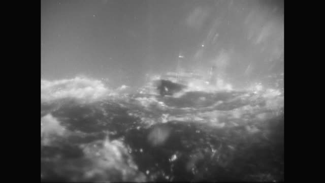 ws model steam ship sailing in rough, stormy sea with high waves / united states - 沈没する点の映像素材/bロール