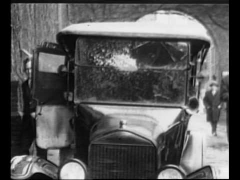 model t approaches through arch of driveway stops industrialist henry ford decars helps inventor thomas edison decar /montage edison and ford stand... - model t stock videos and b-roll footage