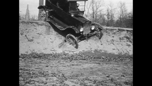 model t ford cars navigate poor roads - model t stock videos and b-roll footage