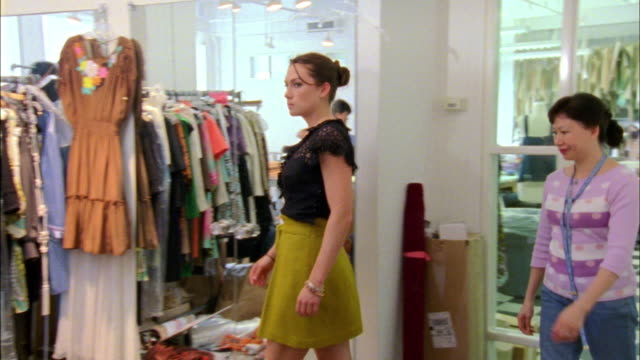 ms zo zi model trying on clothes at fashion designer's workshop, new york city, new york, usa - fashion designer stock videos & royalty-free footage