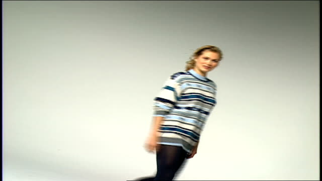 model walking around in blue striped sweater and black tights - tights stock videos & royalty-free footage