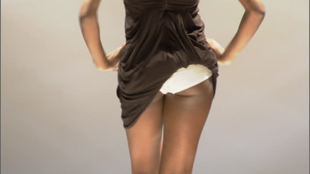 vidéos et rushes de ms model walking with dress tucked into her underwear on catwalk / london, england, uk - fashion show