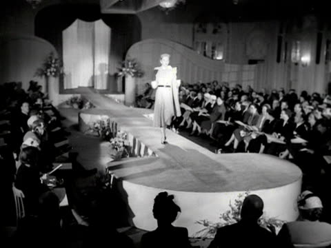 a model walks down a catwalk wearing a wool dress and a wrap 1953 - wrap dress stock videos and b-roll footage