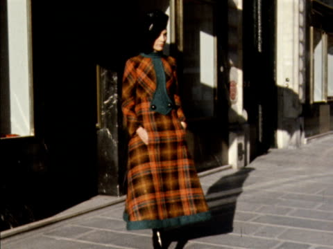 a model walks out of a shop and poses wearing a tartan dress 1970 - tartan stock videos & royalty-free footage