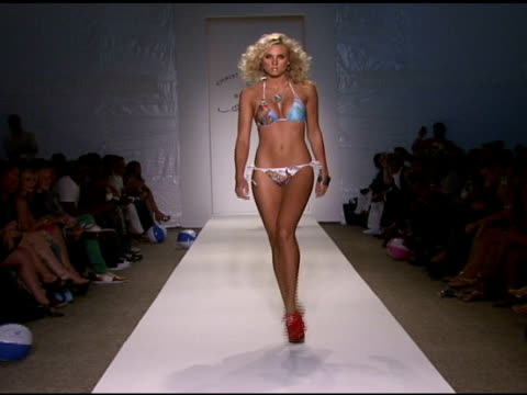 a model walks the runway at ed hardy swimwear 2009 collection fashion show during mercedesbenz fashion week swim at the raleigh hotel on july 18 2008... - mercedes benz fashion week stock videos & royalty-free footage