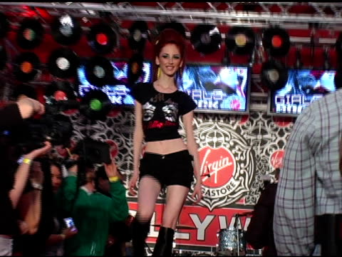 model walks the runway at the virgin megastore hollywood launch of their new fashion and accessories line with a rock n roll girls rock fashion show... - ヴァージンレコード点の映像素材/bロール