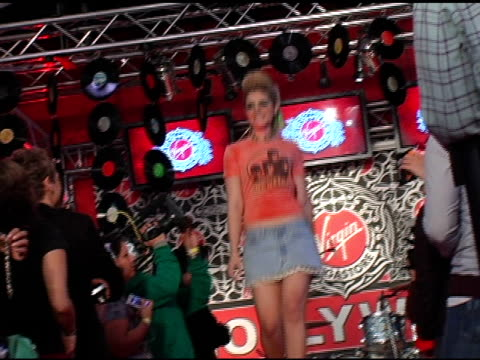 model walks the runway at the virgin megastore hollywood launch of their new fashion and accessories line with a rock n roll girls rock fashion show... - virgin megastore点の映像素材/bロール