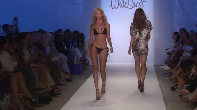 a model walks the runway at the white sands 2010 fashion show at the mbfw miami swim 2010 collection white sands australia runway at miami beach fl - fashion collection stock videos & royalty-free footage