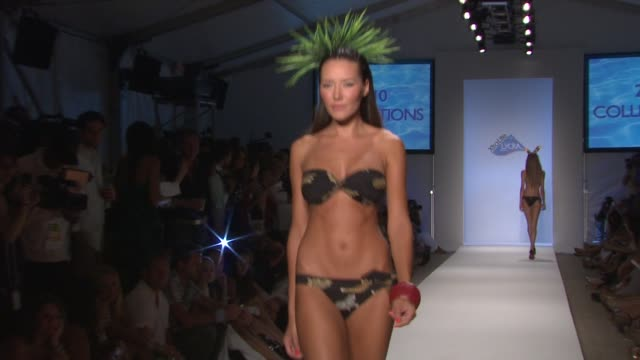 a model walks the runway at the xtra life lycra 2010 fashion show during mercedesbenz fashion week swim at the raleigh on july 18 2009 in miami beach... - lycra stock videos & royalty-free footage