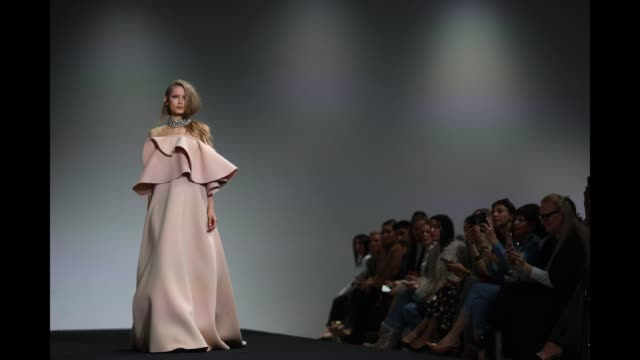 a model walks the runway during the mariam seddiq show at mercedesbenz fashion week resort 20 collections at carriageworks on may 14 2019 in sydney... - australian fashion week stock videos & royalty-free footage