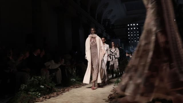 stockvideo's en b-roll-footage met model walks the runway during the ralph & russo show as part of the paris fashion week womenswear fall/winter 2020/2021 on february 28, 2020 in... - fashion show