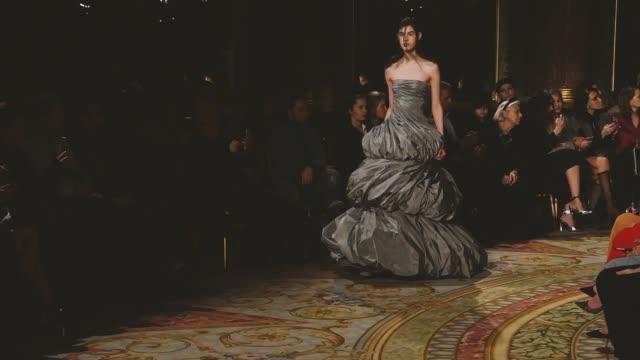 model walks the runway during the valentin yudashkin show as part of the paris fashion week womenswear fall/winter 2018/2019 on march 5, 2018 in... - 既製服点の映像素材/bロール