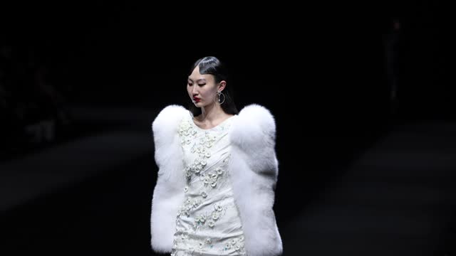 model walks the runway during the youg x collection show by chinese designer xing yong on day seven at china fashion week a/w 2021/2022 on march 30,... - fashion collection stock videos & royalty-free footage