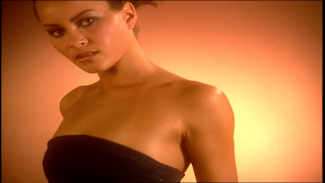 model wearing a dark colored camisole and gold pants - camisole stock videos & royalty-free footage