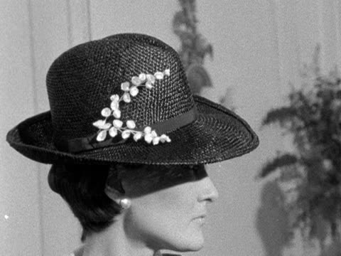 a model wearing a straw trilby stands next to two models wearing bonnie and clyde inspired outfits designed by hardie amies 1968 - strohhut stock-videos und b-roll-filmmaterial