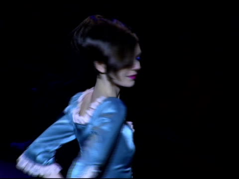 model wearing betsey johnson fall 2006 at the olympus fashion week fall 2006 betsey johnson backstage and runway at the promenade, bryant park in new... - オリンパスファッションウィーク点の映像素材/bロール