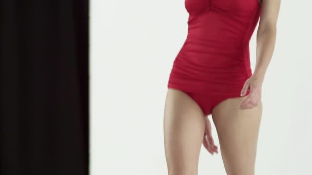 model wearing red swimsuit on catwalk at fashion show - laufsteg stock-videos und b-roll-filmmaterial