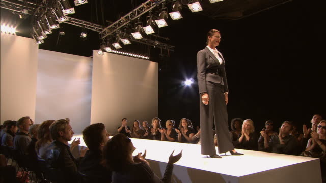 ws model wearing suit with a large belt posing on catwalk at fashion show/ london, england - catwalk stock videos & royalty-free footage