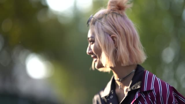 model wears a balck and purple striped silky shirt dress, outside andrew gn, during paris fashion week womenswear spring/summer 2019, on september... - 背が高い点の映像素材/bロール
