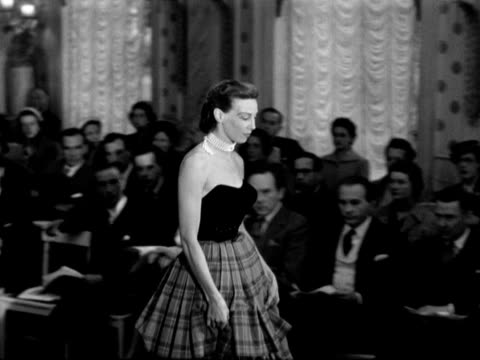 model wears a ball gown with a strapless bodice and a checked skirt at a fashion show. - strapless stock videos & royalty-free footage