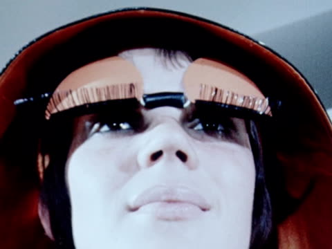 a model wears a bizarre pair of sun blinds with stylised eyelids and eyelashes attached 1970 - pair stock videos & royalty-free footage