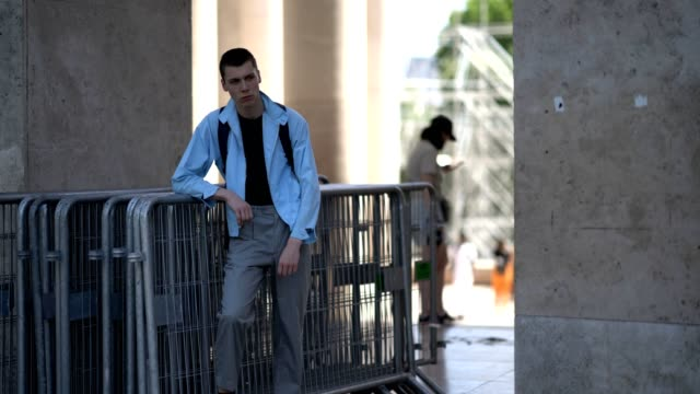 model wears a blue jacket, gray cropped pants, outside the 22/4 hommes show, during paris fashion week - menswear spring/summer 2018, on june 23,... - gray jacket stock videos & royalty-free footage