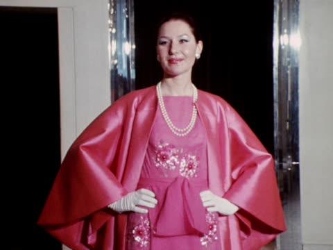 vídeos y material grabado en eventos de stock de model wears a bright pink embroidered dress with a matching silk coat designed by norman hartnell. - vestimenta para mujer