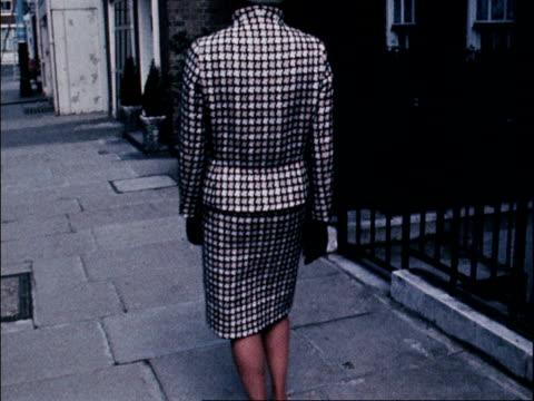 vídeos y material grabado en eventos de stock de model wears a checked skirt and jacket designed by lachasse. 1968. - vestimenta para mujer