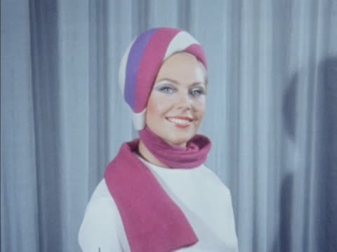 stockvideo's en b-roll-footage met a model wears a colourful hat with a scarf attached - dameskleding
