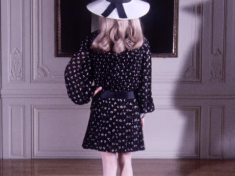 A model wears a Dior patterned mini dress