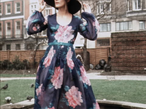 a model wears a floral dress and matching hat designed by clive - sun hat stock videos & royalty-free footage