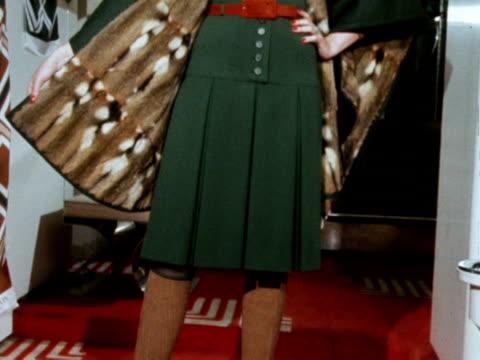 stockvideo's en b-roll-footage met model wears a fur lined coat. - winterjas