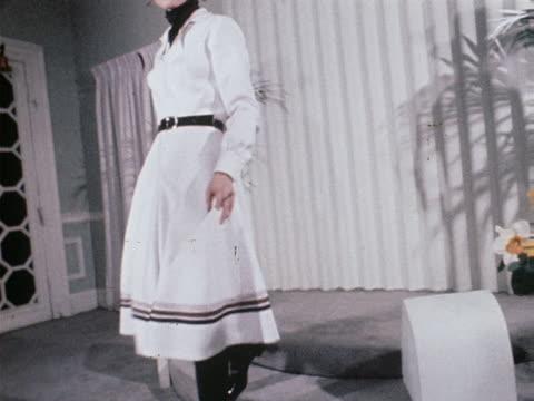 vídeos de stock e filmes b-roll de model wears a gaucho style suit with black hat and boots at a rahvis fashion show. - gaúcho