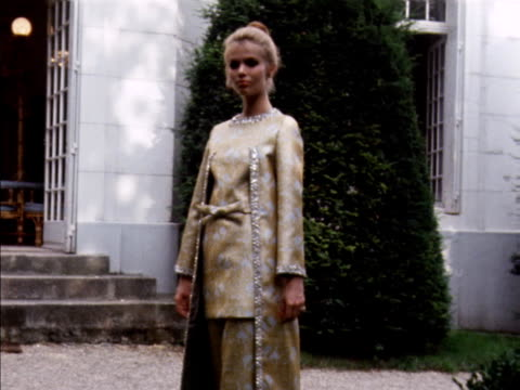a model wears a gold and silver lame evening tunic and trousers with a matching coat designed by jacques esterel - tunic stock videos & royalty-free footage