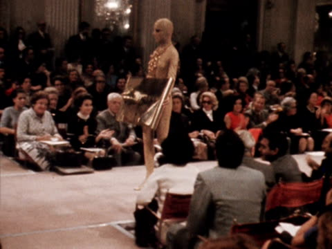 a model wears a gold lame body suit designed by prince irene galitzine at a fashion show in florence - fashion collection stock videos & royalty-free footage