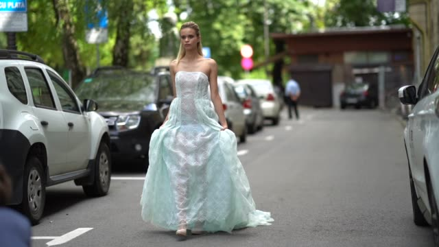 a model wears a green lace mesh wedding dress outside cindyalan during feeric fashion week 2018 on july 21 2018 in sibiu romania - lace textile stock videos & royalty-free footage