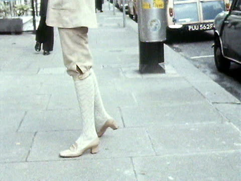model wears a khaki knickerbocker suit and hat designed by norman hartnell. 1970. - bloomers stock videos & royalty-free footage