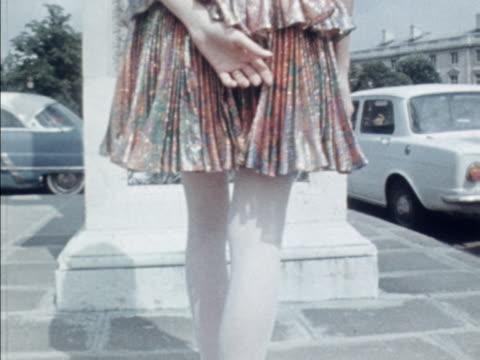 A model wears a mini metallic cocktail dress