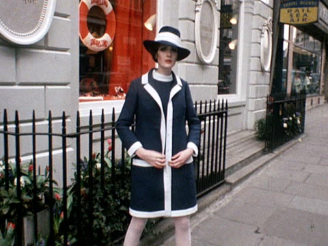 A model wears a navy and white coat with matching dress and coat designed by Jorn Langberg for Christian Dior 1968